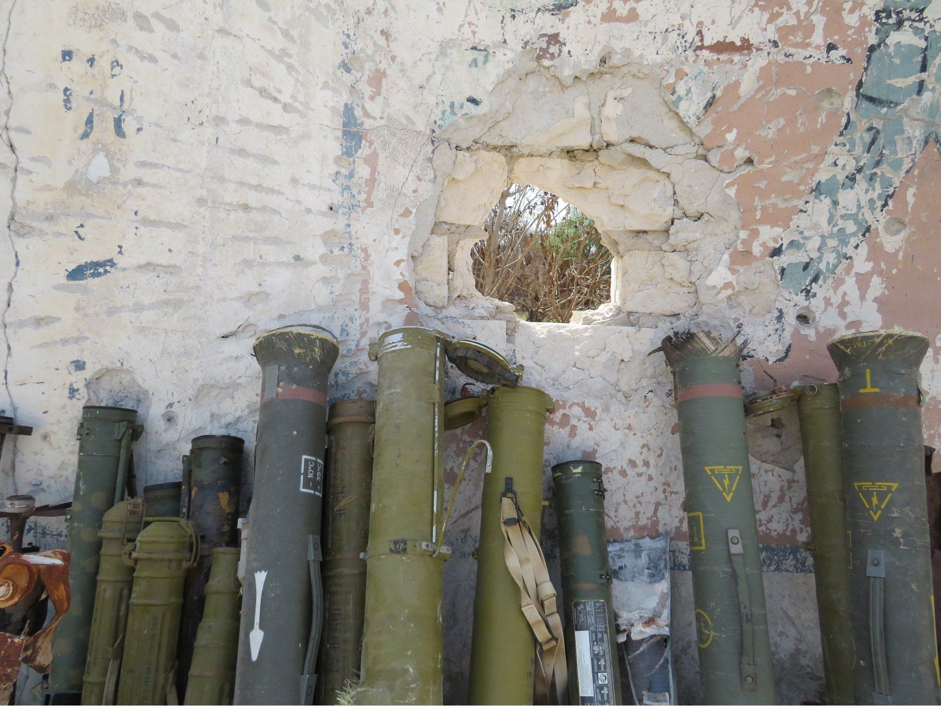 Rocket launchers recovered from residential battlefields and brought to a military base in Tripoli (MEE/Daniel Hilton)