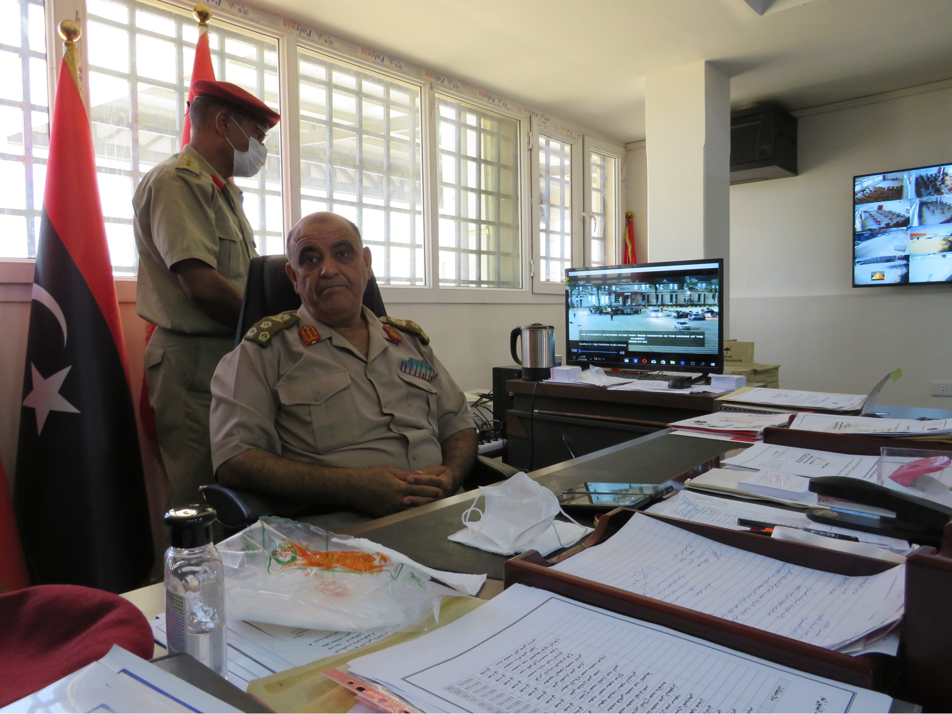 Brigadier General Khaled Ali Ahmed bin Omar turns away from a screen showing footage of the bombing (MEE/Daniel Hilton)