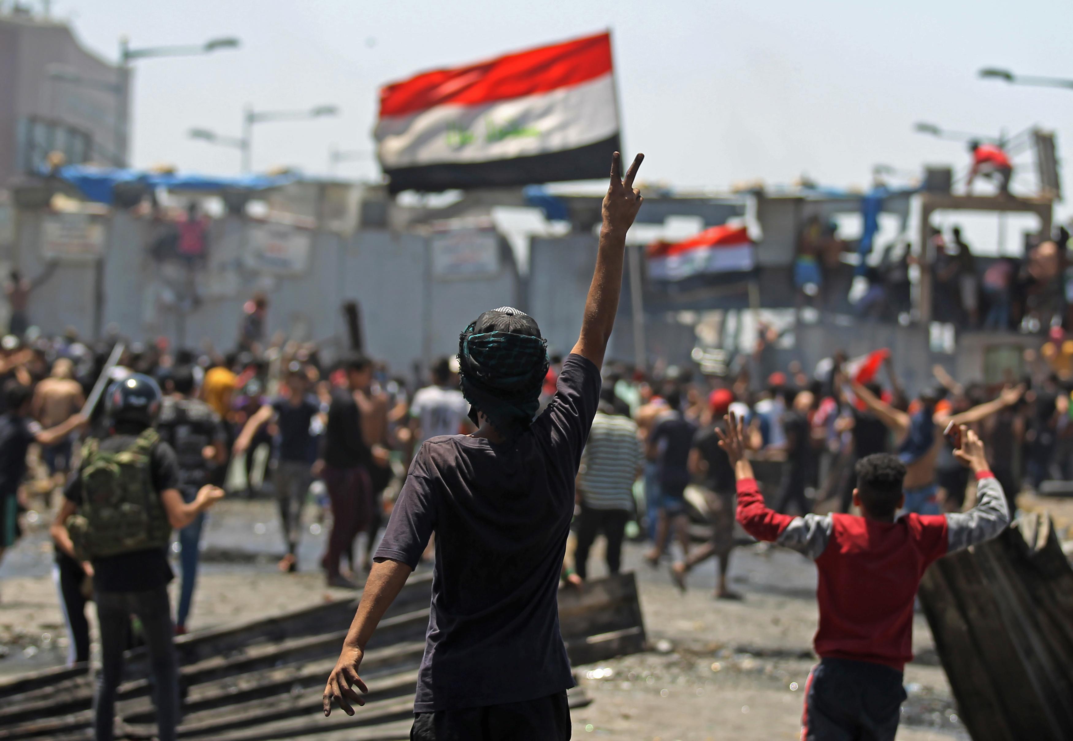 'Man of settlements': Iraq's Kadhimi walks the line in anti-corruption drive Iraq%20demonstration