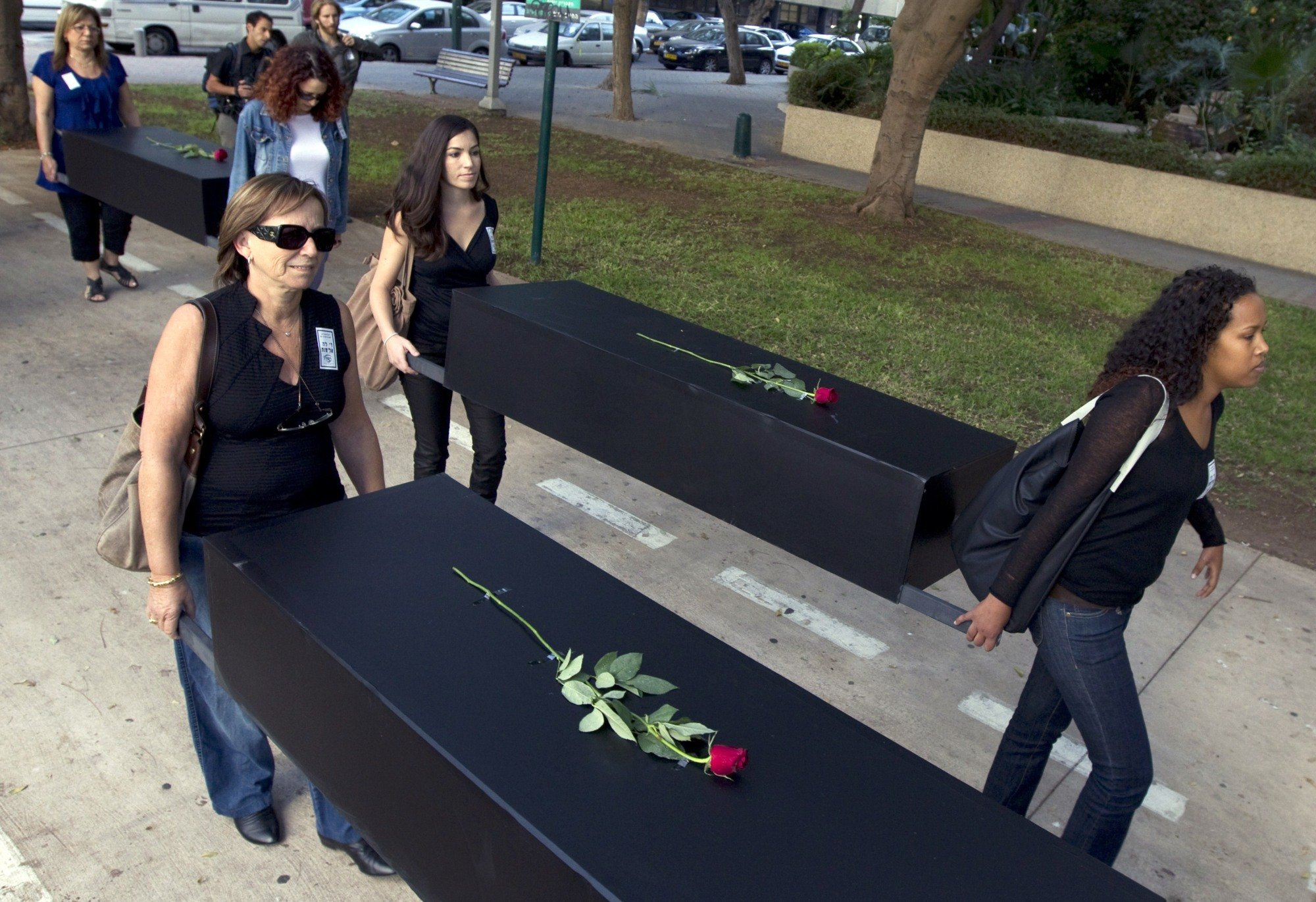 Israelis take part in a mock funeral to raise the alarm over the growing number of women being killed in incidents of domestic violence across Israel on 25 November 2010 in Tel Aviv (AFP)