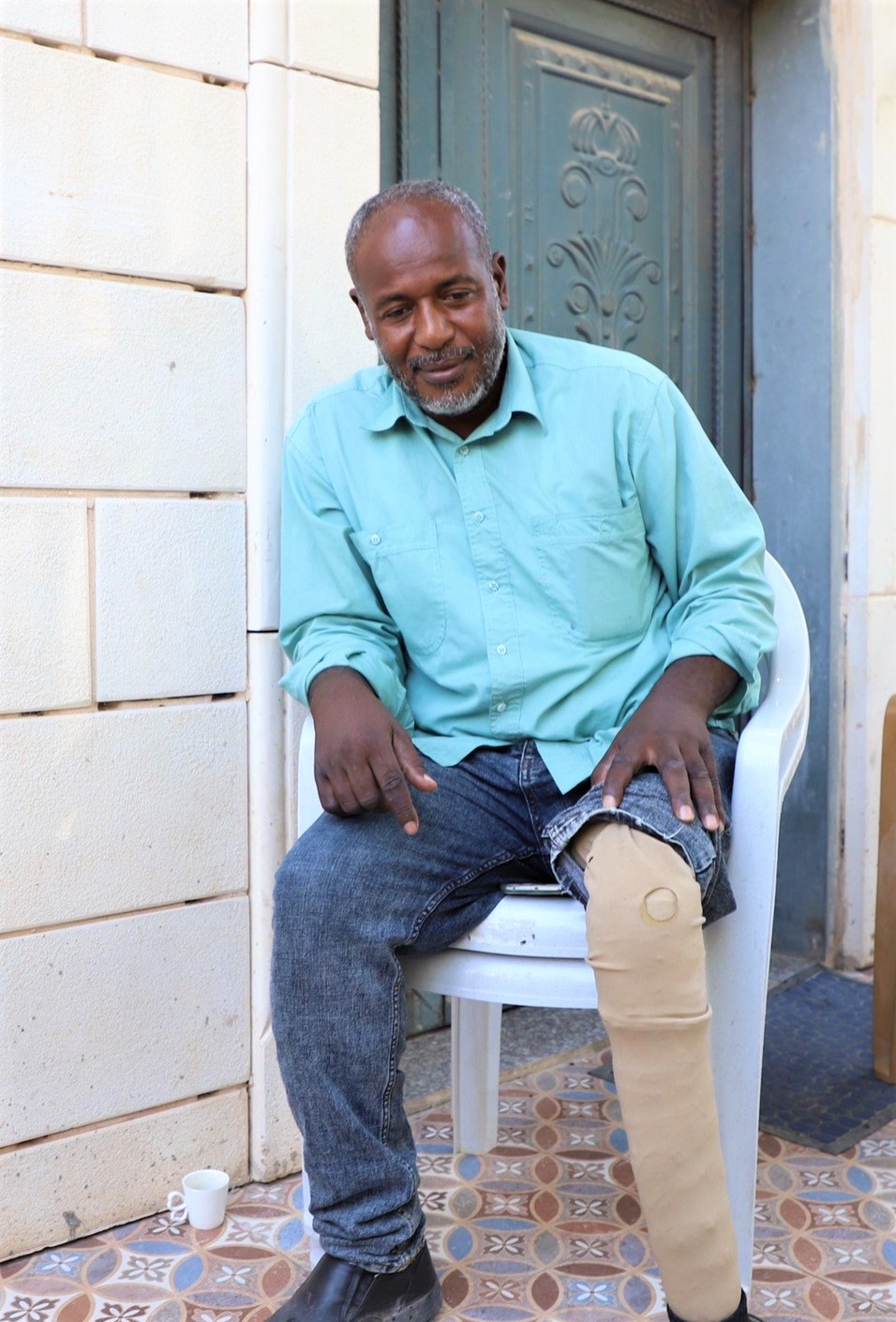 Joma'a Abu-Jabal shows the prosthetic leg he uses after Israeli forces shot his leg which was later amputated
