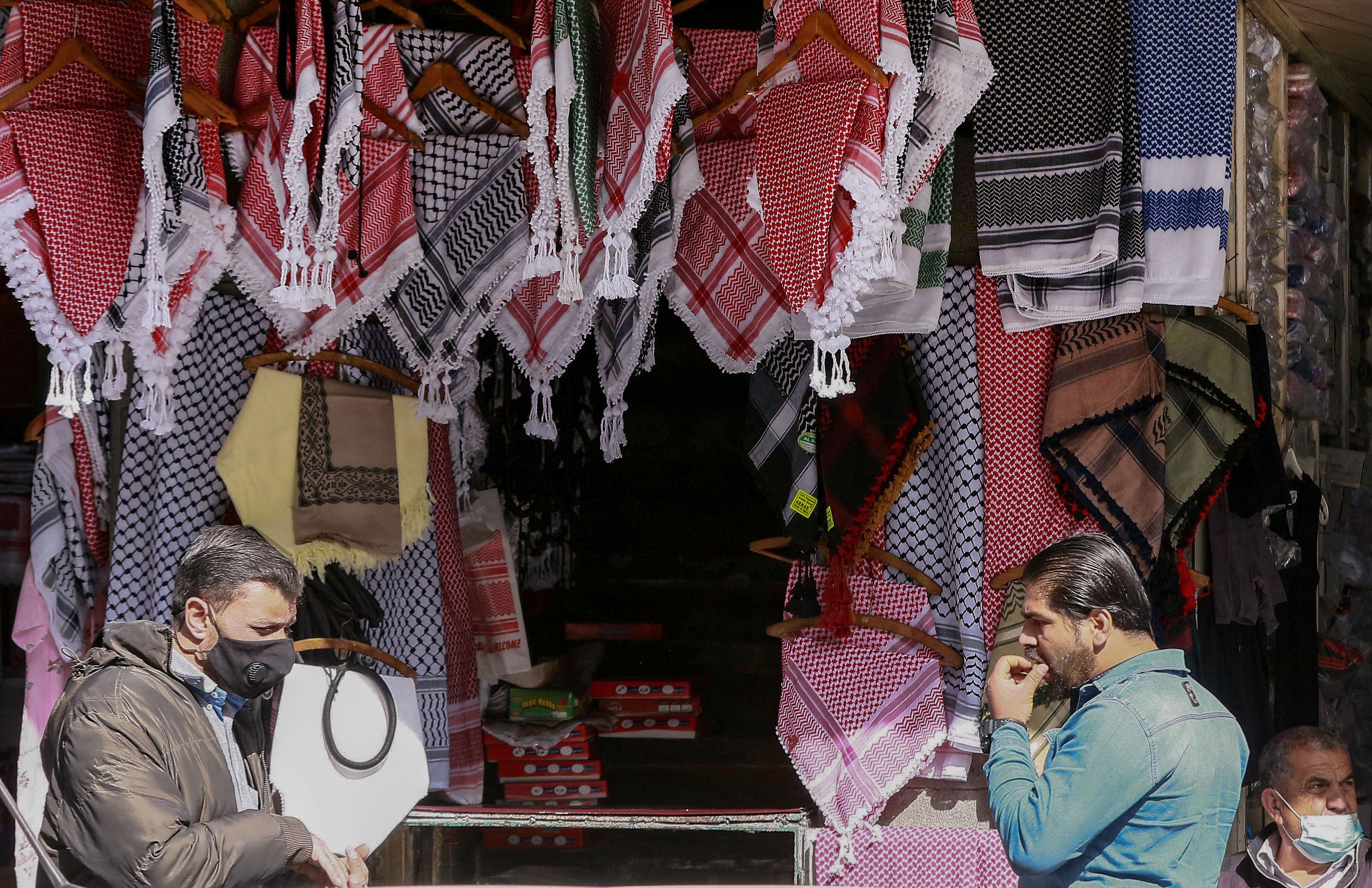Keffiyeh's in different colours and fabrics are now available the world over (AFP)