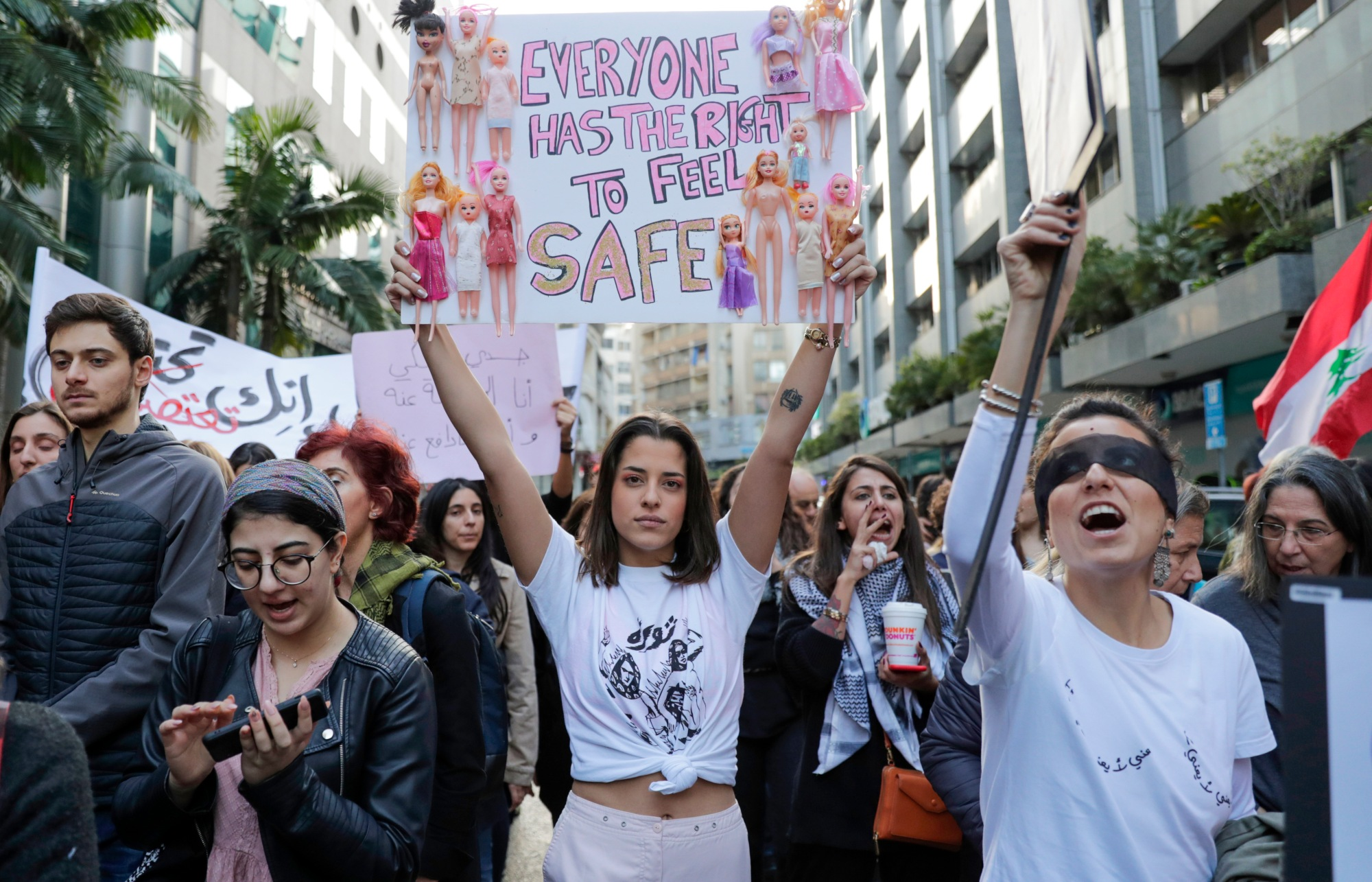 Activists take part in a demonstration against sexual harassment, rape and domestic violence in the Lebanese capital Beirut on 7 December 2019 (AFP)