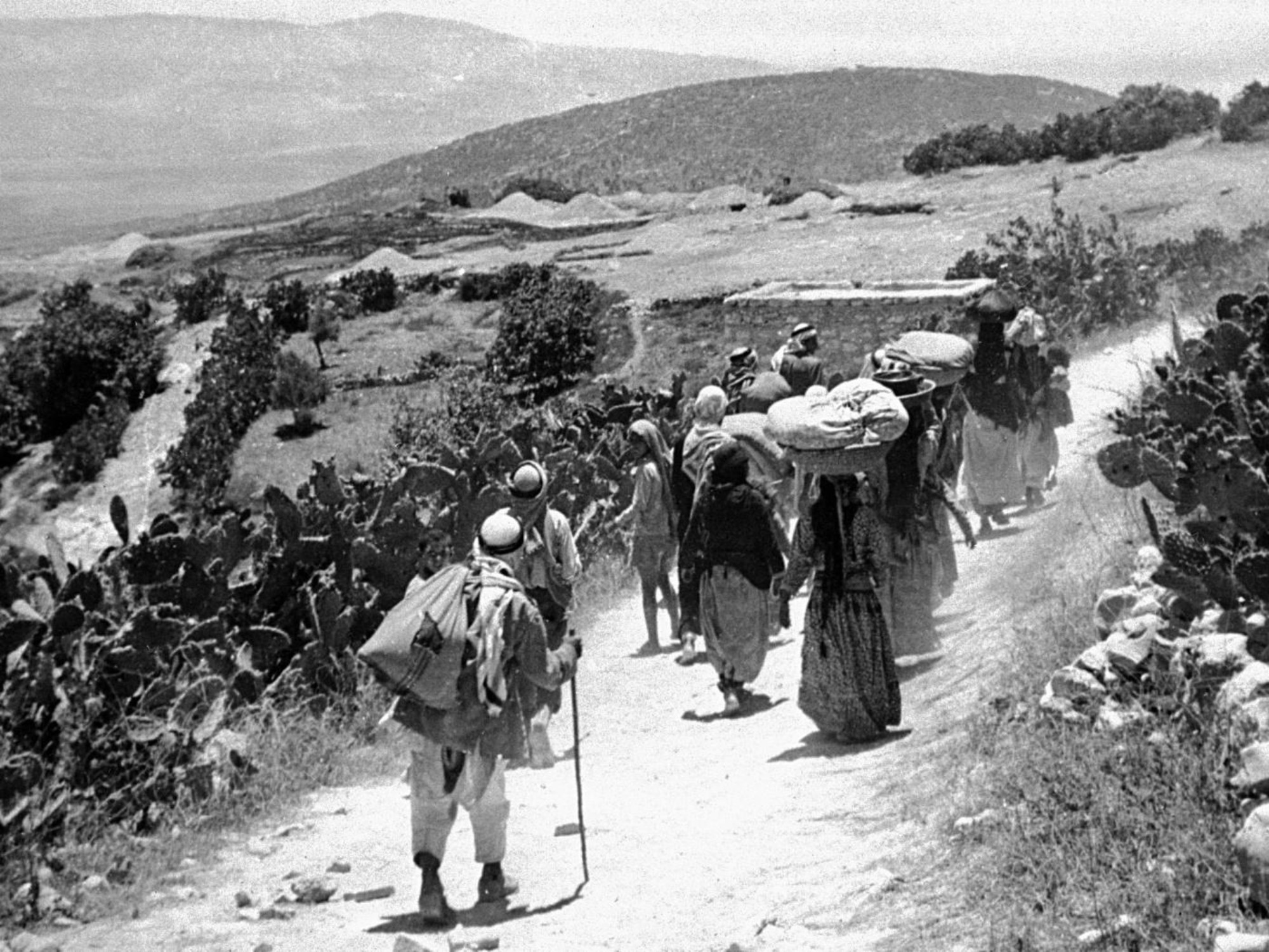 Palestinians flee the village of Qumiya during the Nakba in 1948 (Archive/Palestine Remembered)
