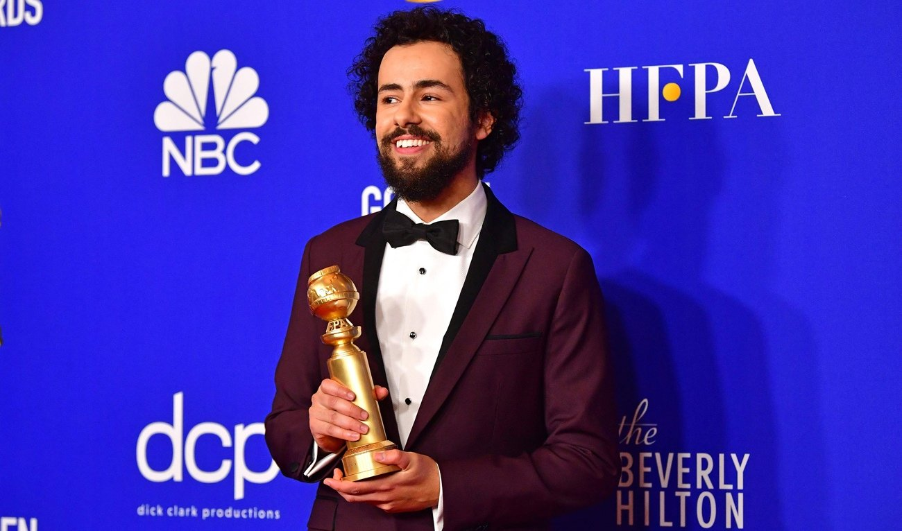 Ramy Youssef collects his Golden Globe for Best Actor (Musical or Comedy) in January 2020 (AFP)