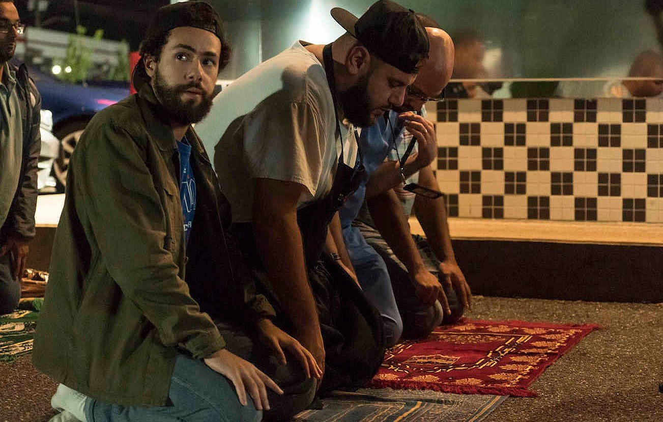 Ramy at prayer - but it fails to resolve his moral confusion (Hulu)
