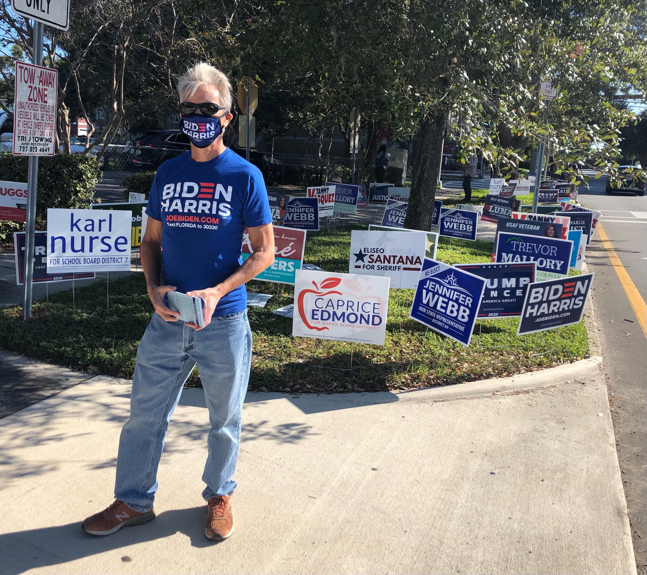 Robert, originally British but a registered US voter for almost a decade, stands outside a polling place to show his support for presidential nominee Joe Biden on 3 November (MEE/Sheren Khalel)