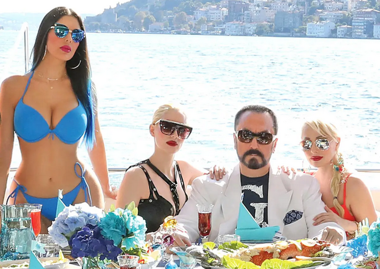 Adnan Oktar and his 'kittens' (Global Ltd)