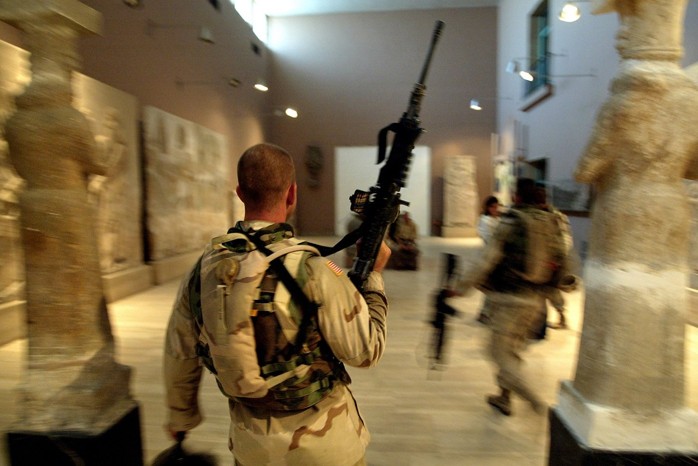 Two US soldiers from the 1st Division, 2nd Bridage, Texas, visit the Iraq Museum 10 September 2003 in Baghdad AFP
