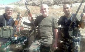 Adel El Zabayar posing with pro-Assad militia in 2011 (Social media)
