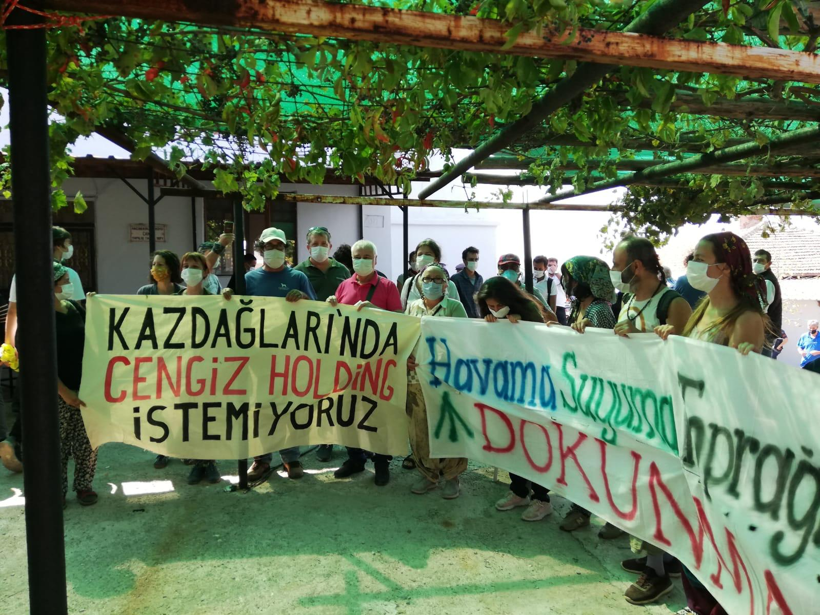 Activists hold up a banner reading 'we don't want Cengiz Holding in Mount Ida' (Kazdagi Association)