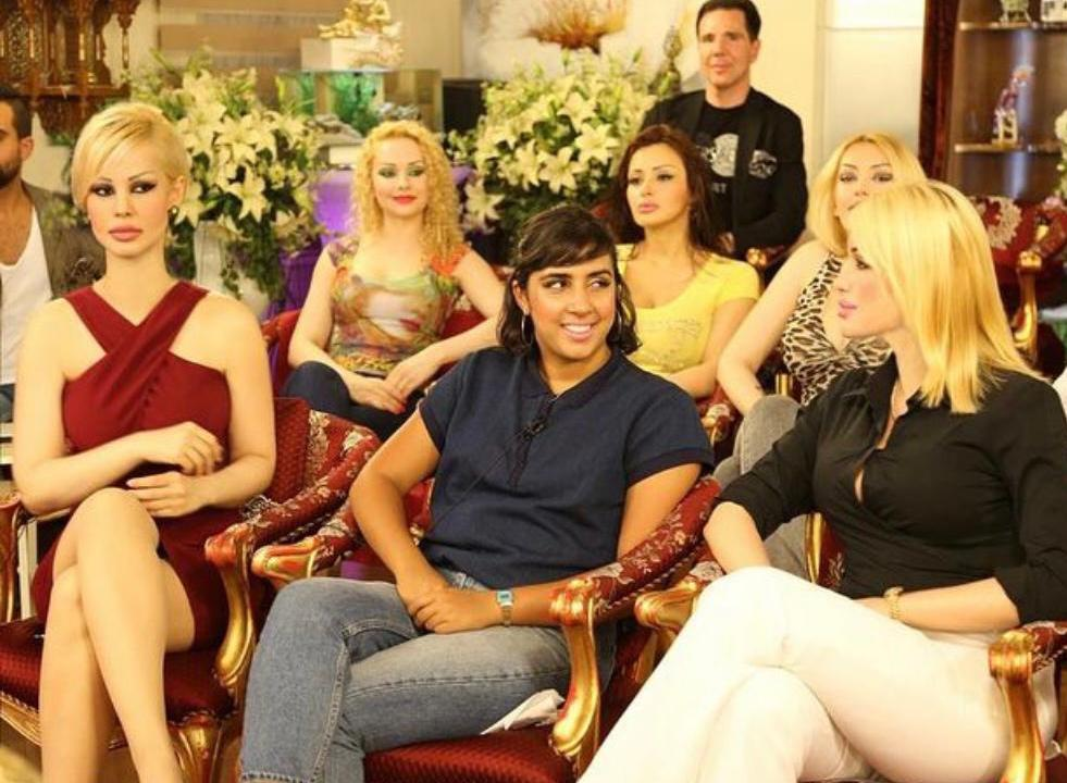 Meher Ahmad sitting with Adnan Oktar's 'kittens' on the set of his TV show (Meher Ahmad)