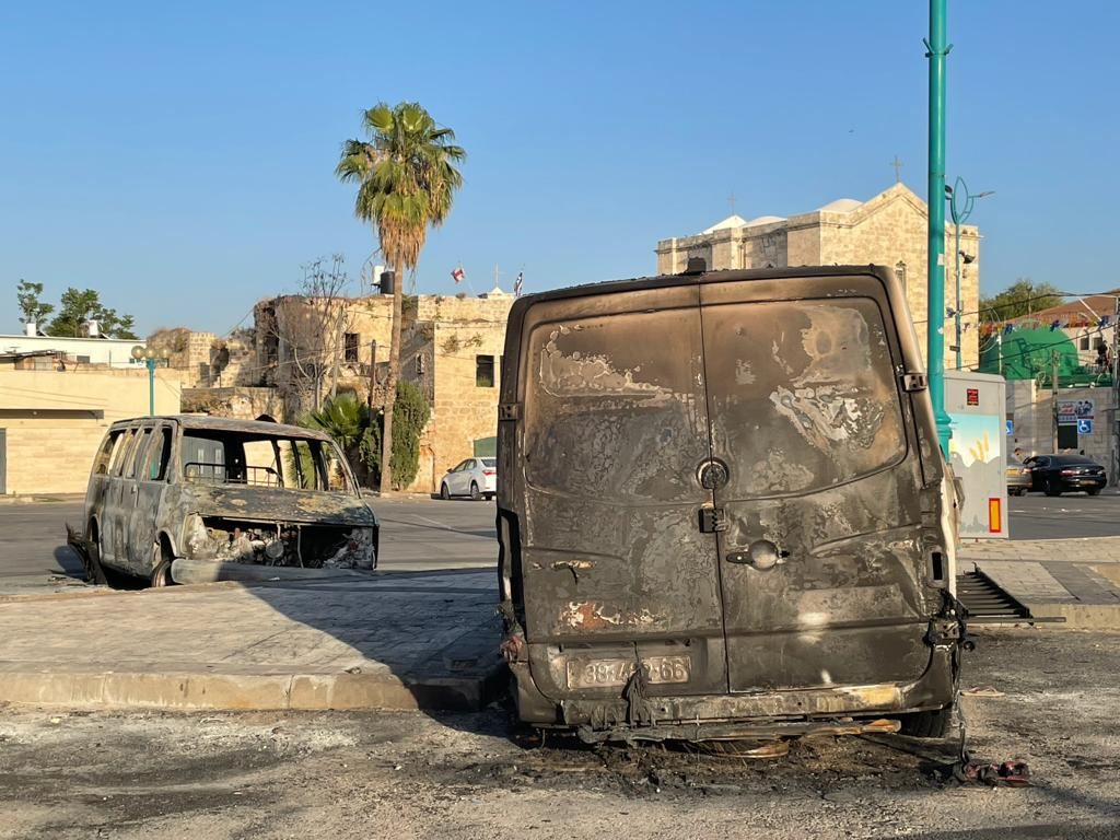 Burnt out vehicles from the previous nights' violence, 12 May, 2021. (MEE/Lubna Marsawa)