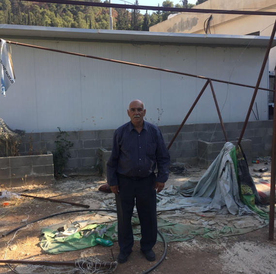 Adel Jabori, a resident of Wadi Yasul, says the ultimate aim it to uproot the Palestinians, their buildings, trees and families (MEE/Jan-Peter Westad)