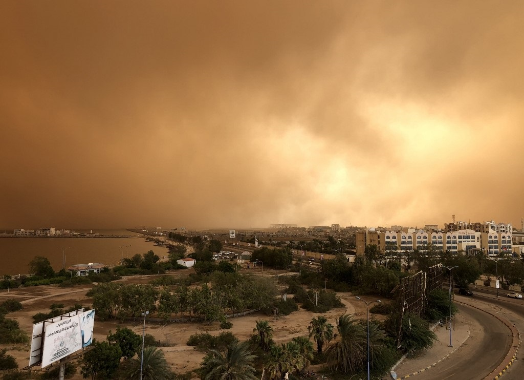 A sand storm approaches Aden in September (AFP)