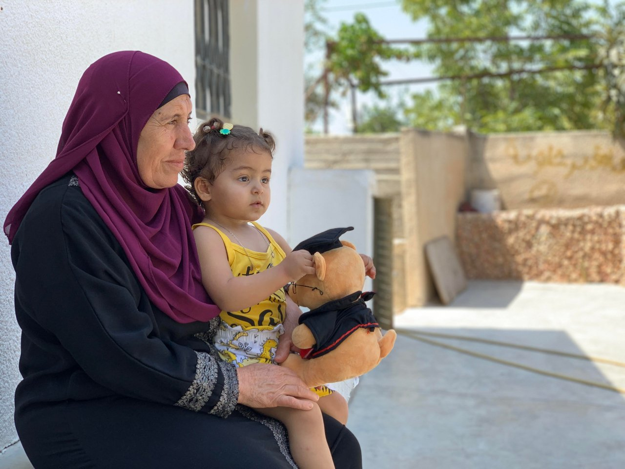 Anhar's mother, 57-year-old Aisha, now spends her time looking after her one-and-a half-year-old granddaughter Julia (Shatha Hammad)