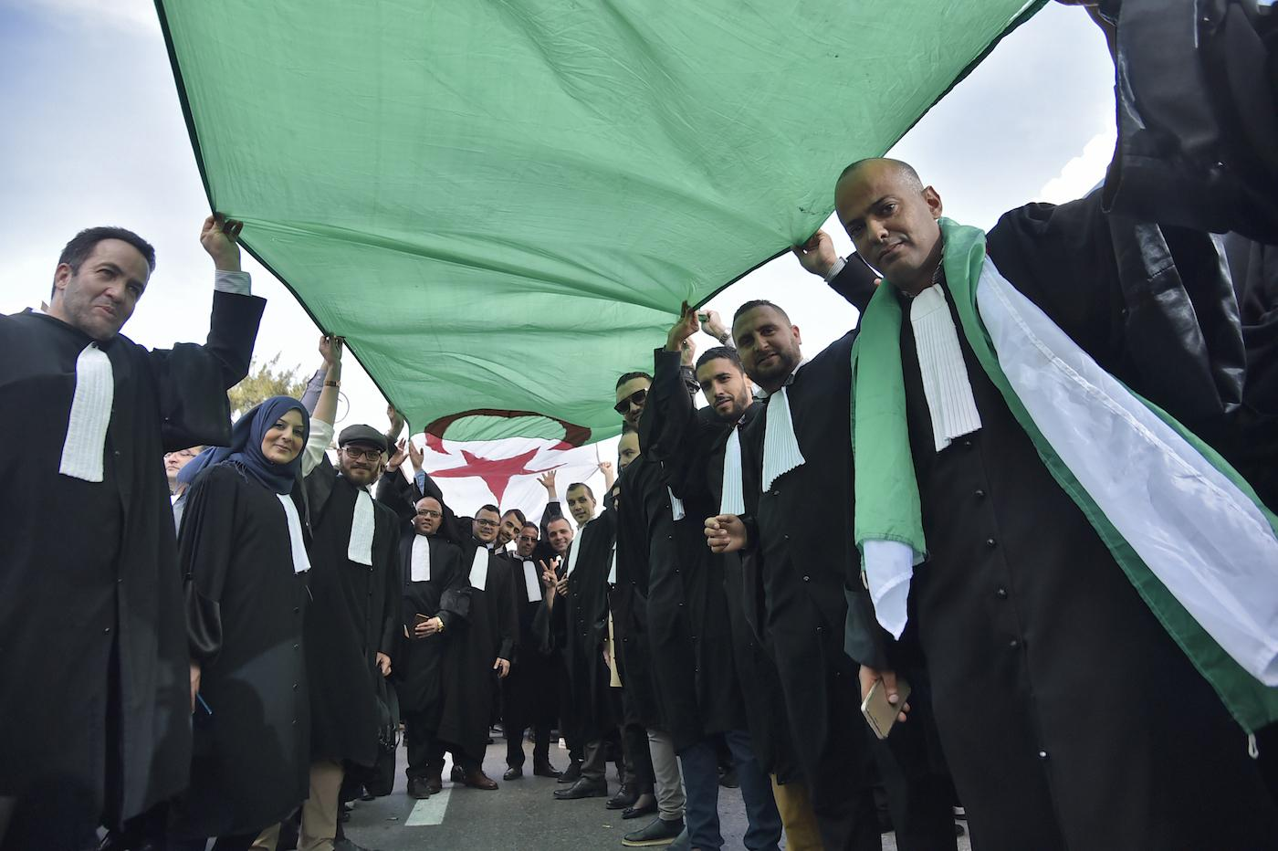 Lawyers protest against Abdelaziz Bouteflika's candidacy in Algiers on 7 March (AFP)