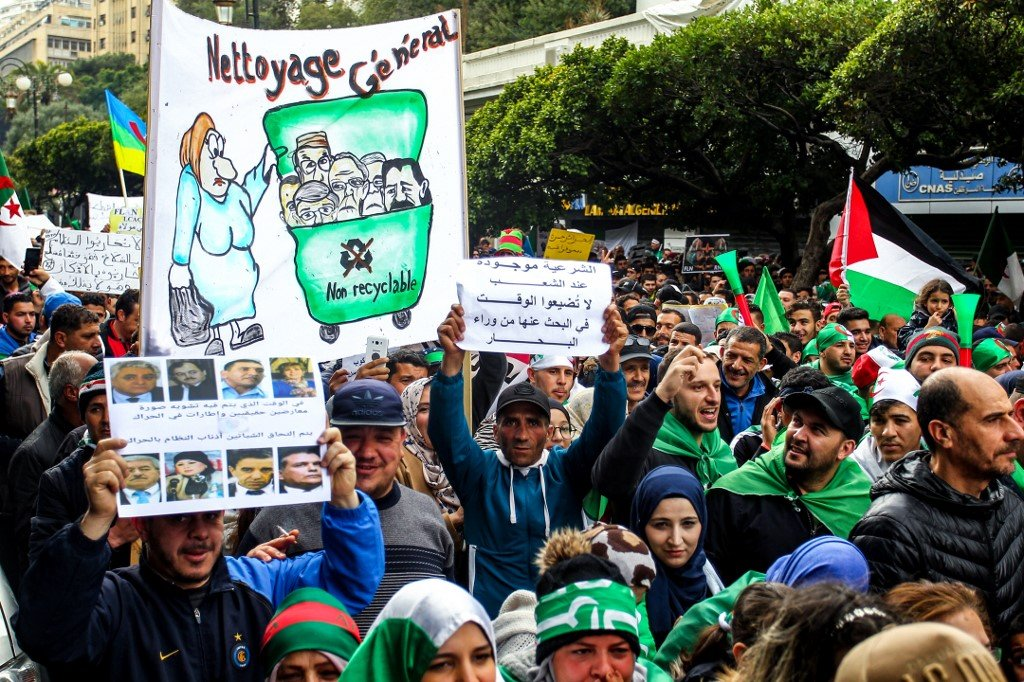 Algerians take part in anti-government protests in Algiers on 22 March (AFP)