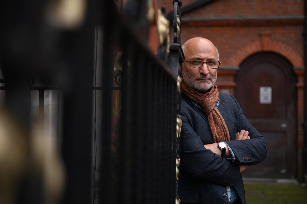 Coup 53 director Taghi Amirani poses in London on 4 October 2019 (AFP)
