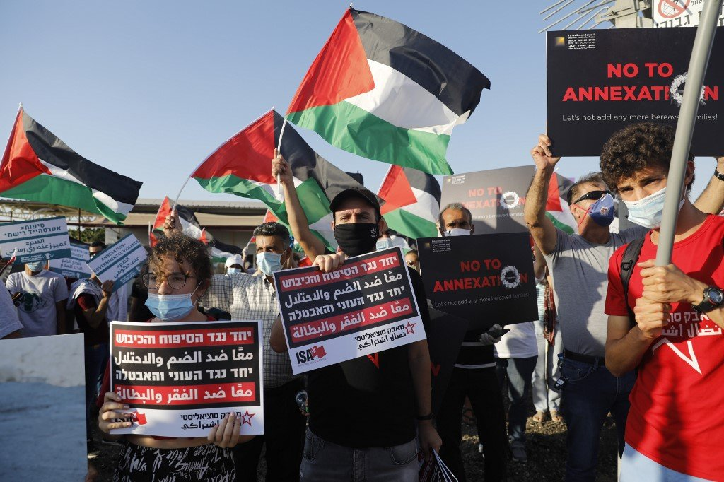 Palestinian and Israeli activists protest annexation south of Jericho on 27 June (AFP)