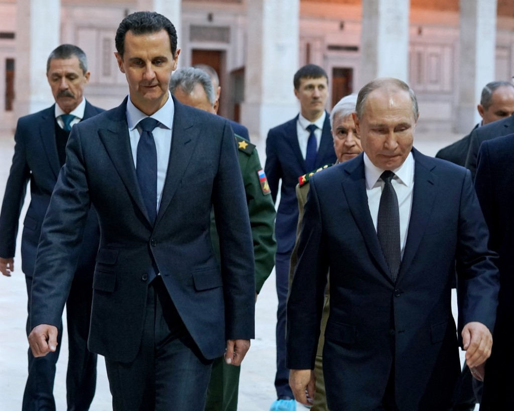 Syrian President Bashar al-Assad and Putin are pictured in Damascus on 7 January 2020 (SANA/AFP)