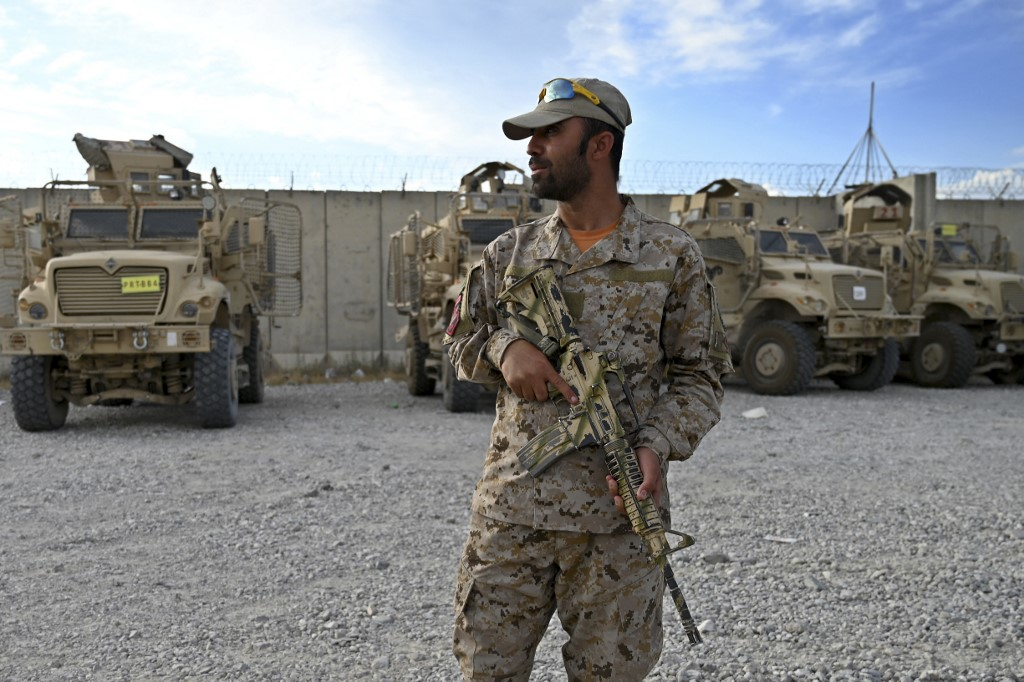 An Afghan police officer stands guard at the Bagram US air base after all US and NATO troops left on 5 July 2021 (AFP)