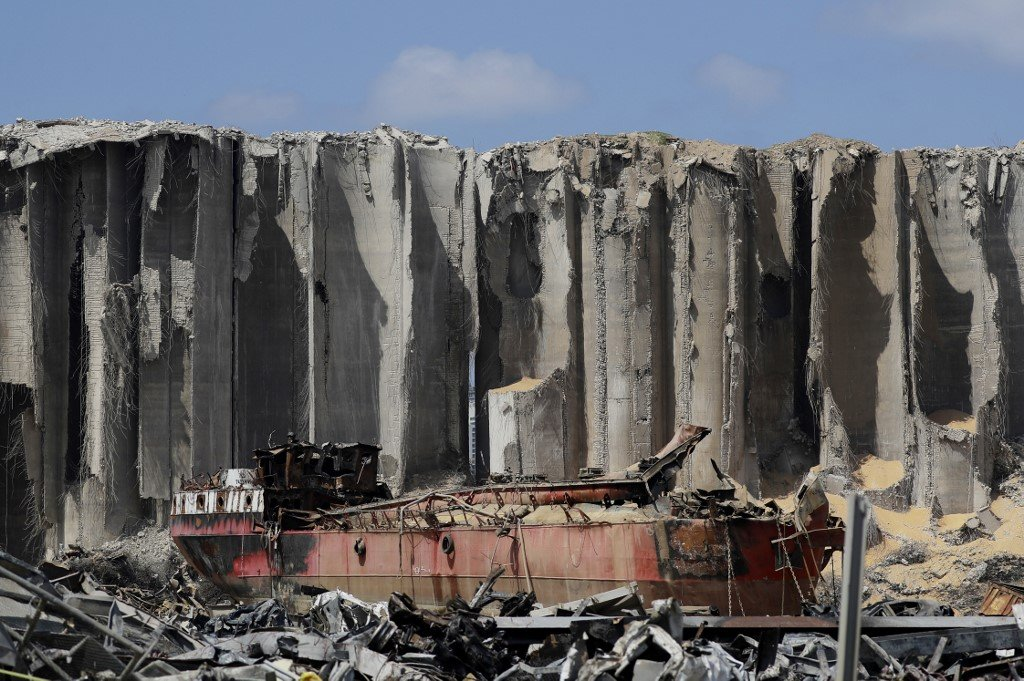 Damaged grain silos stand at the port of Beirut on 26 August (AFP)