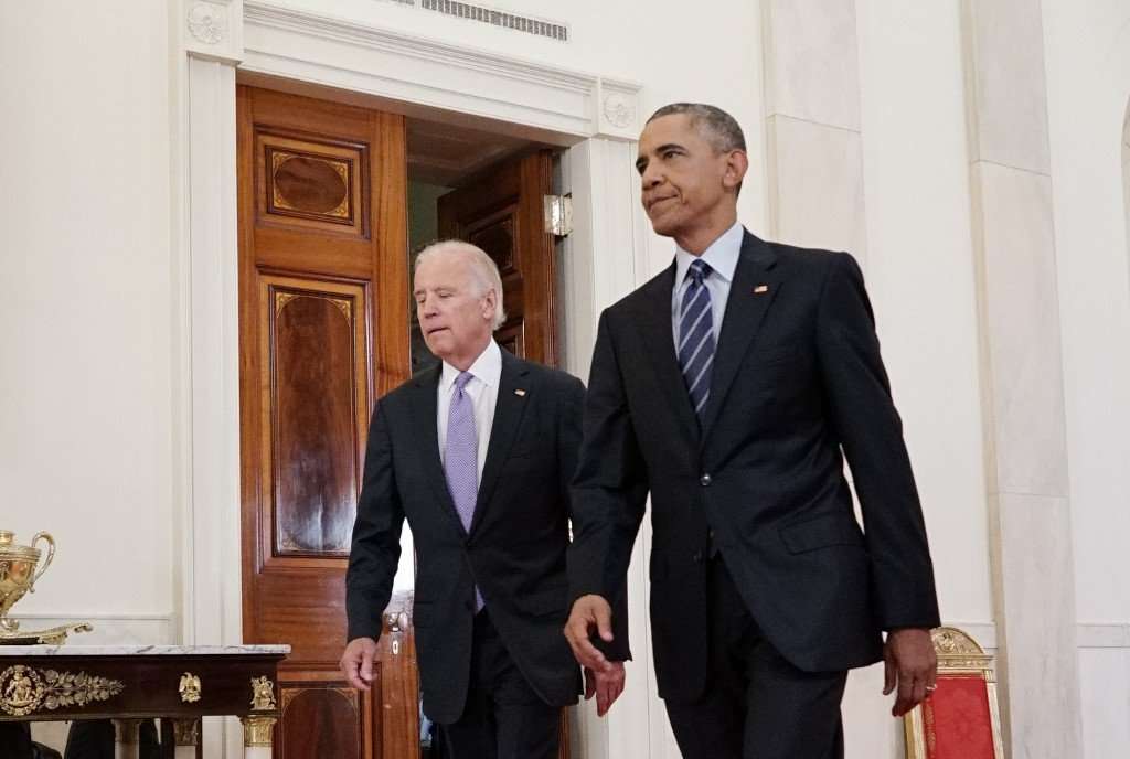 Biden, then the vice president, is pictured with former President Barack Obama at the White House in Washington in 2015 (AFP)