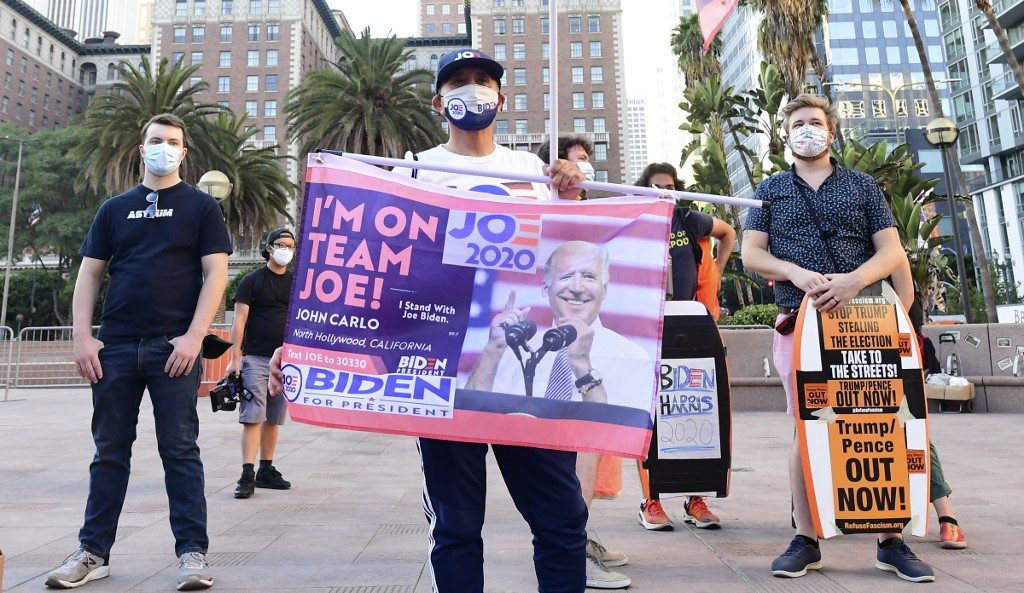 Biden supporters gather for a rally in Los Angeles on 4 November (AFP)