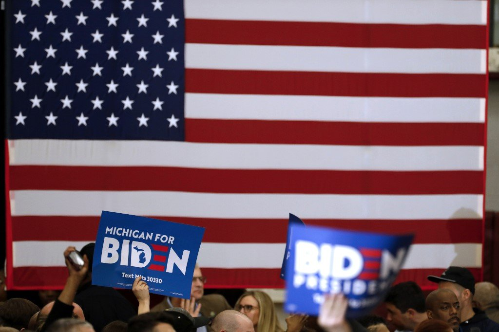 Biden supporters attend a campaign rally in Michigan on 9 March (AFP)