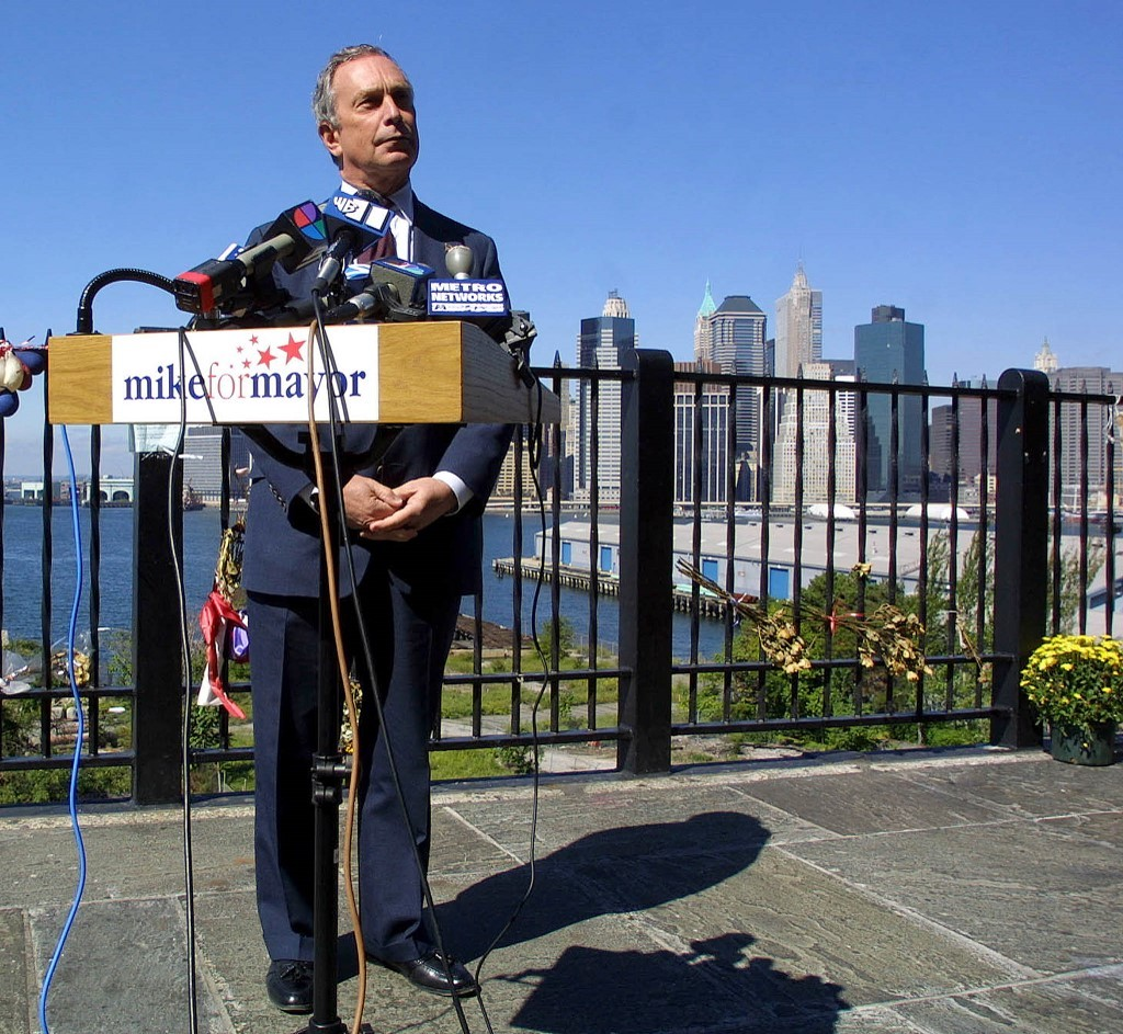 Michael Bloomberg, Republican candidate for New York mayor, speaks to the press in Brooklyn, New York, with lower Manhattan as a backdrop 26 September 2001.