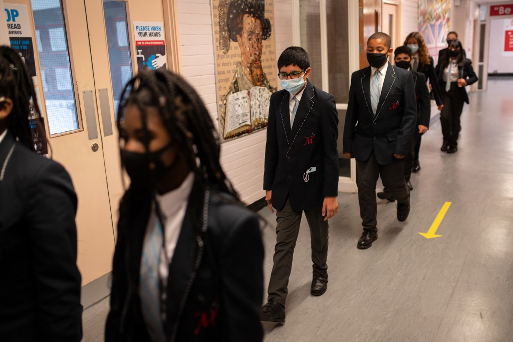 Students wear face masks in Huddersfield, northern England, on 11 September (AFP)