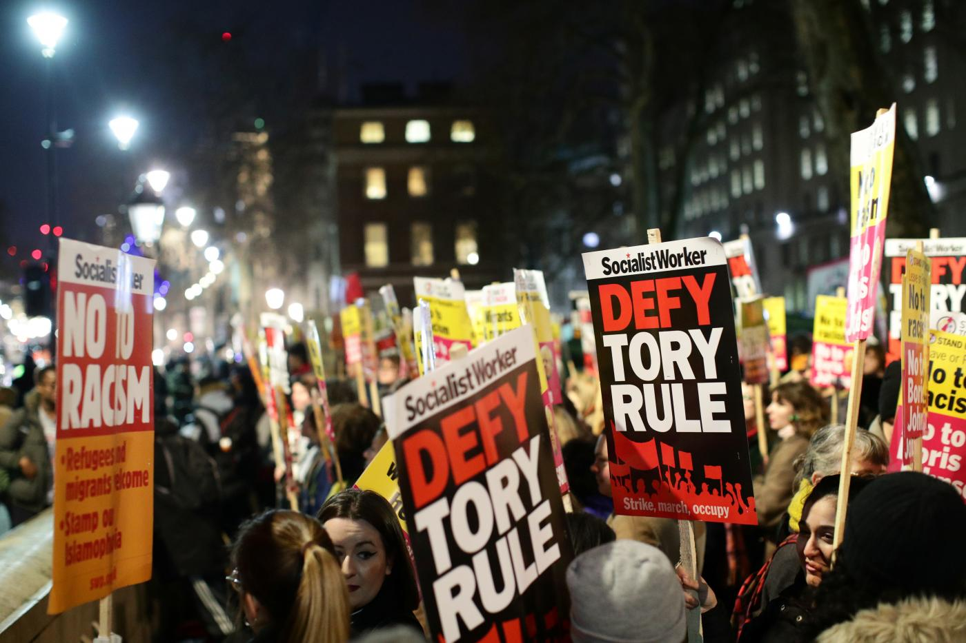 Protesters demonstrate at Downing Street following the result of the general election in London on 13 December (Reuters)