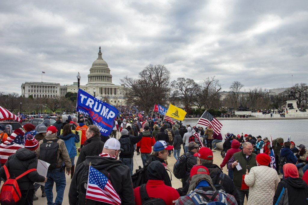 Trump supporters march to the Capitol in Washington on 6 January 2021 (AFP)