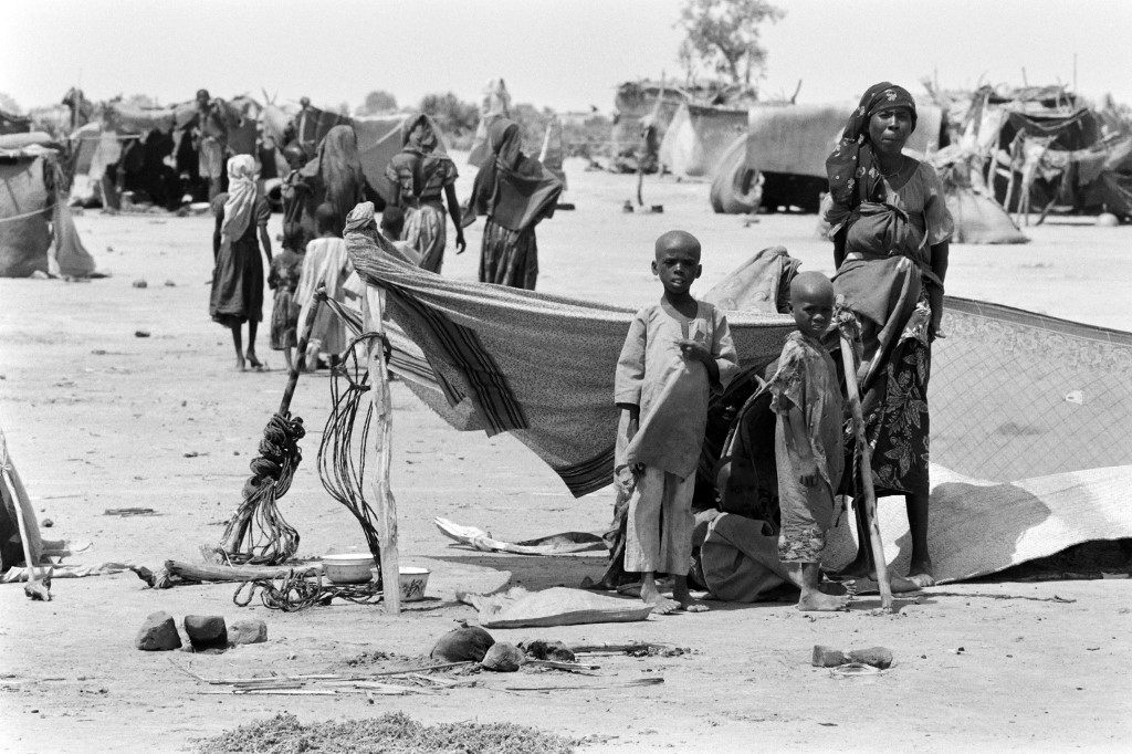 Chadian women and children are pictured at the Ati refugee camp , on October 01, 1984 after being forced to flee their homes due to a famine in consequence of a drought