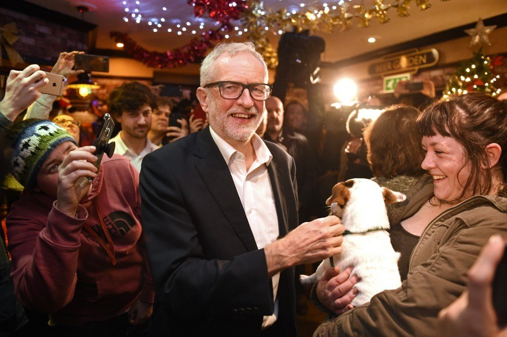 Britain's main opposition Labour party leader Jeremy Corbyn (C) meets supporters during a campaign event in Carlisle, north-west England on December 10, 2019. Britain will go to the polls on December 12, 2019 to vote in a pre-Christmas general election.
