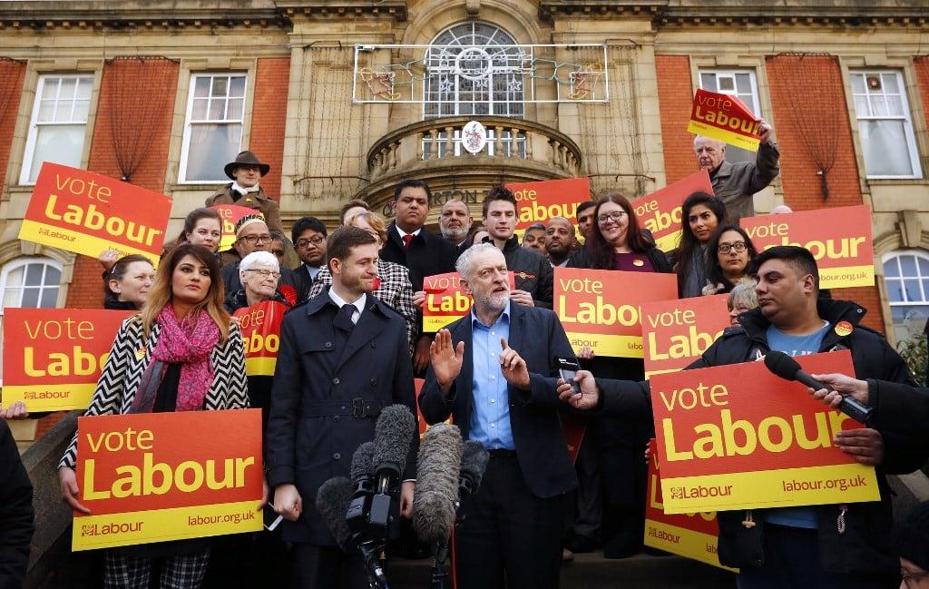 Corbyn speaks outside Chadderton Town Hall in northwest England in 2015 (AFP)