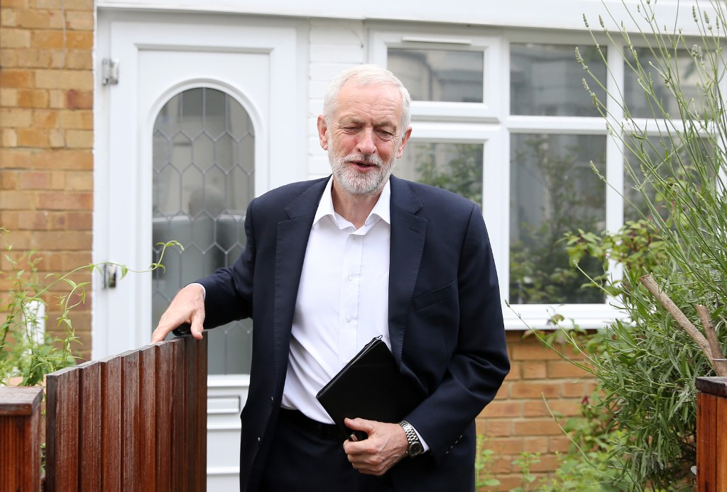British Labour leader Jeremy Corbyn leaves his house in London on 12 June (AFP)