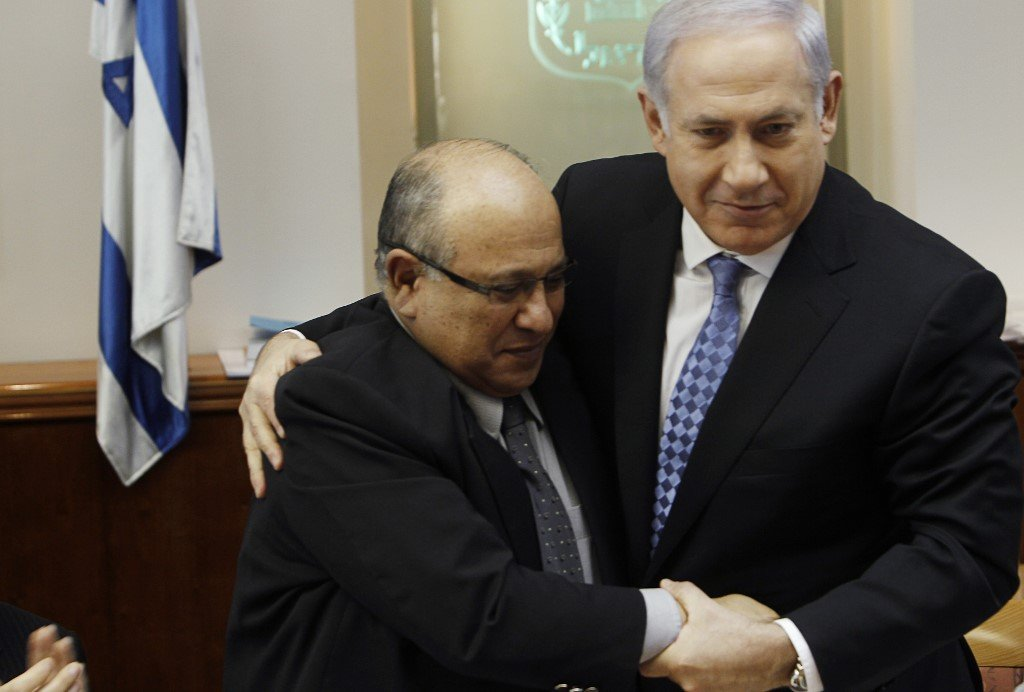 Israeli Prime Minister Benjamin Netanyahu embraces outgoing Mossad director Meir Dagan in Jerusalem on 2 January 2011 (AFP)