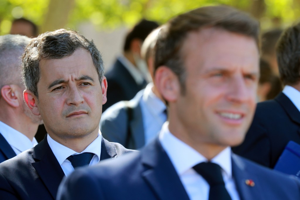 French Interior Minister Gerald Darmanin listens to French President Emmanuel Macron on 22 July 2020 at Chambord castle (AFP)