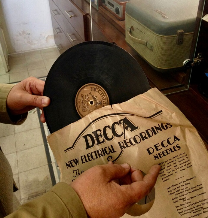 ​  Jalal pulls out the sleeve of an old Decca recording from the Nawa collection (MEE)  ​