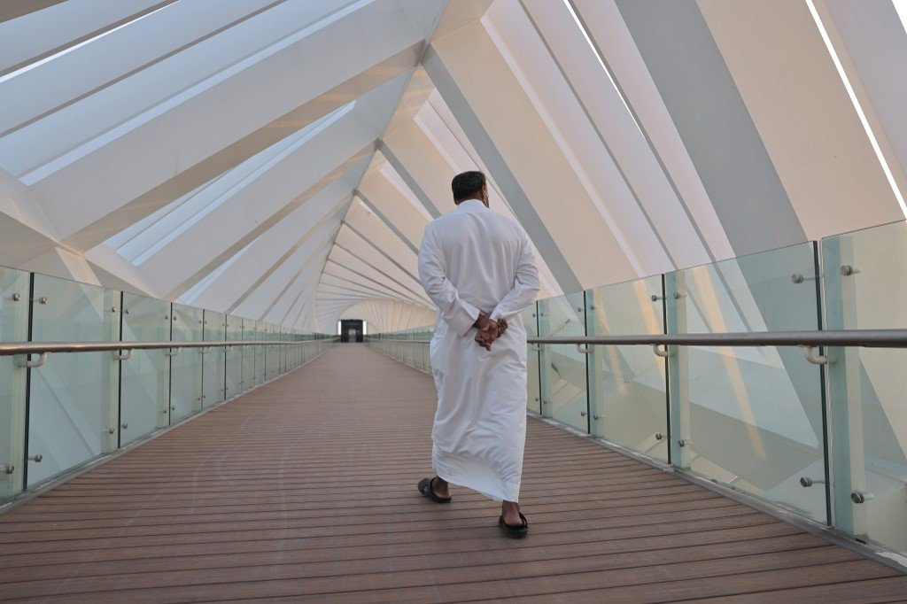 A man crosses the Tolerance bridge in the Gulf emirate of Dubai, on January 25, 2021.