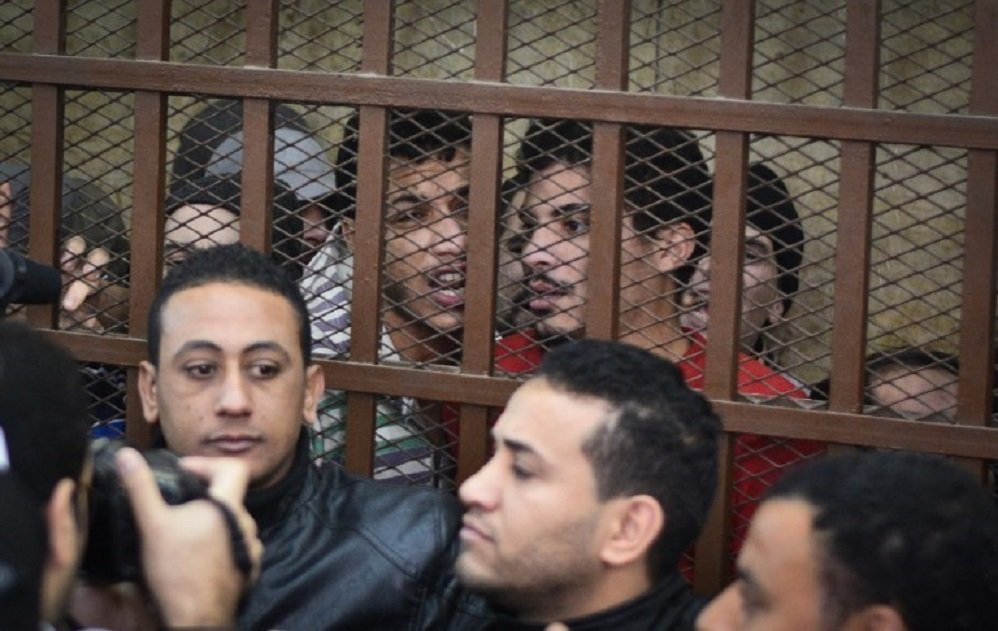 "Defendants react behind the bars at a court in Cairo following the acquittal on 12 January 2015 of 26 men accused of ""debauchery"" after they were arrested in a night-time raid in a bathhouse (AFP)"