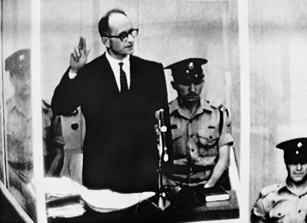 Nazi leader and war criminal Adolf Eichmann stands trial in Jerusalem in 1961 (AFP)