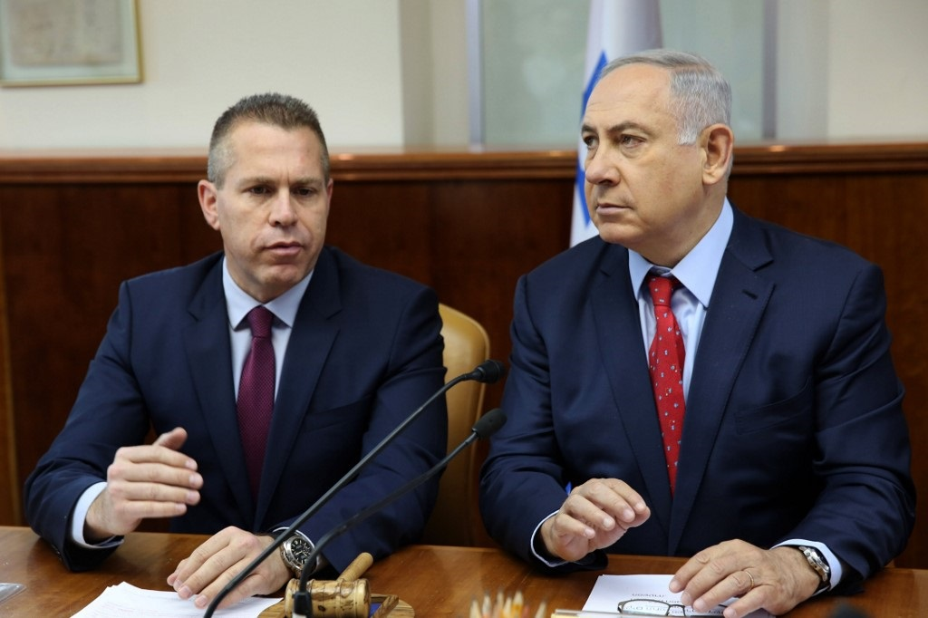 Israeli Prime Minister Benjamin Netanyahu sit with Public Security minister Gilad Erdan during a cabinet meeting in 2016 (AFP)