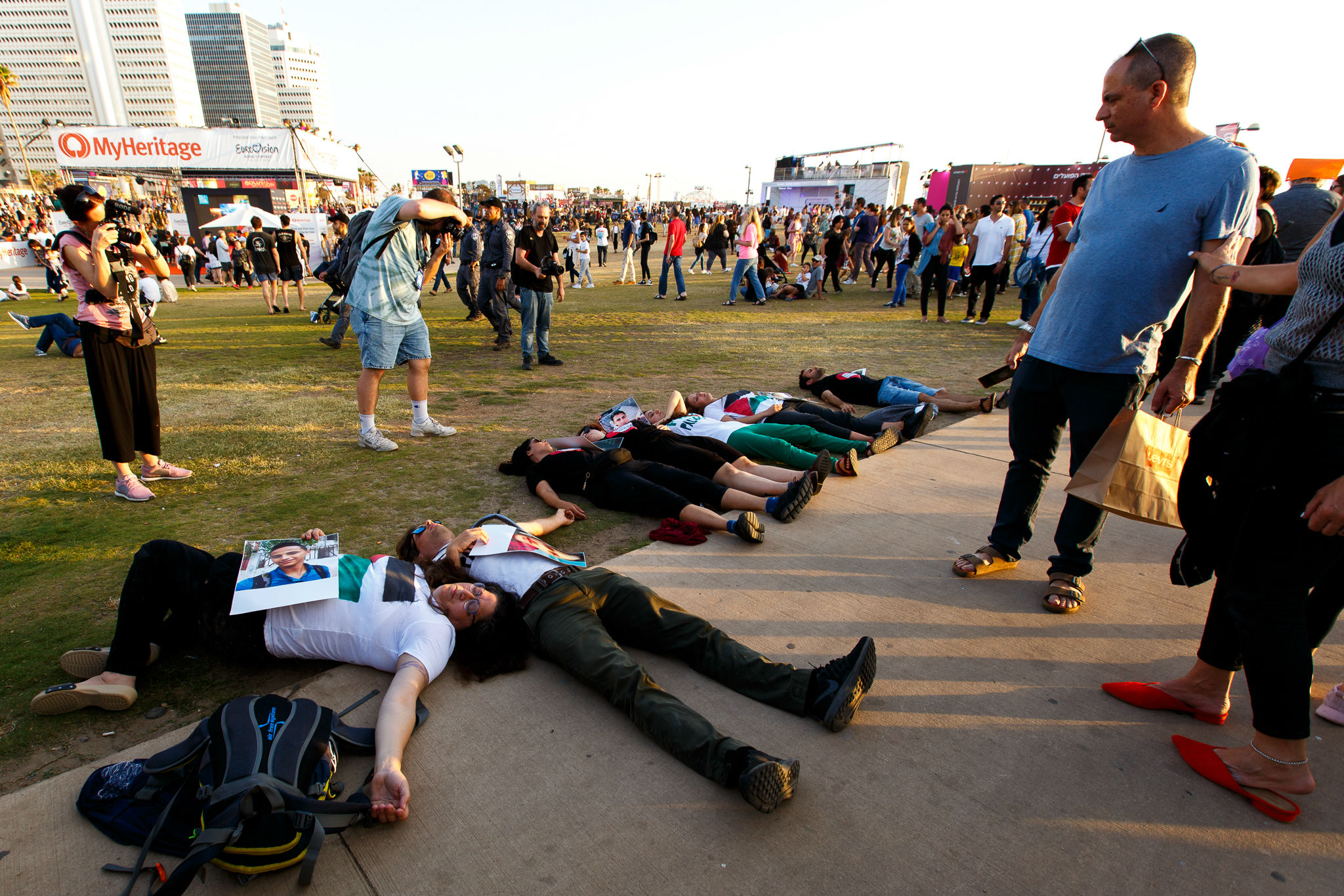 "Israeli activists stage a ""die-in"" at the Eurovision village in Tel Aviv (MEE/Miriam Deprez)"