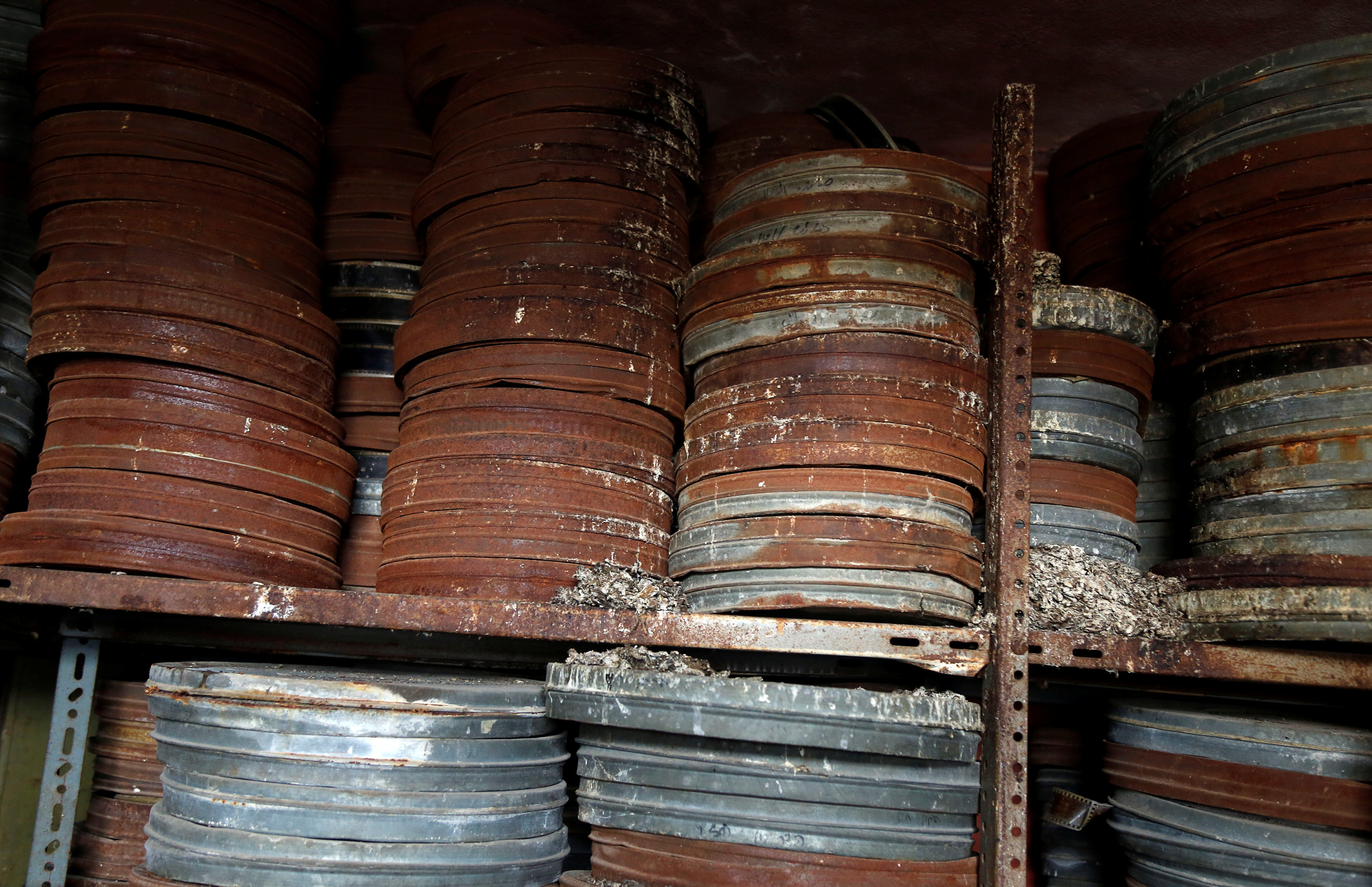 Shelf upon shelf of rusting and corroded film canisters pack the upper floors of the wedding hall: many have not been unsealed for decades. (Reuters)