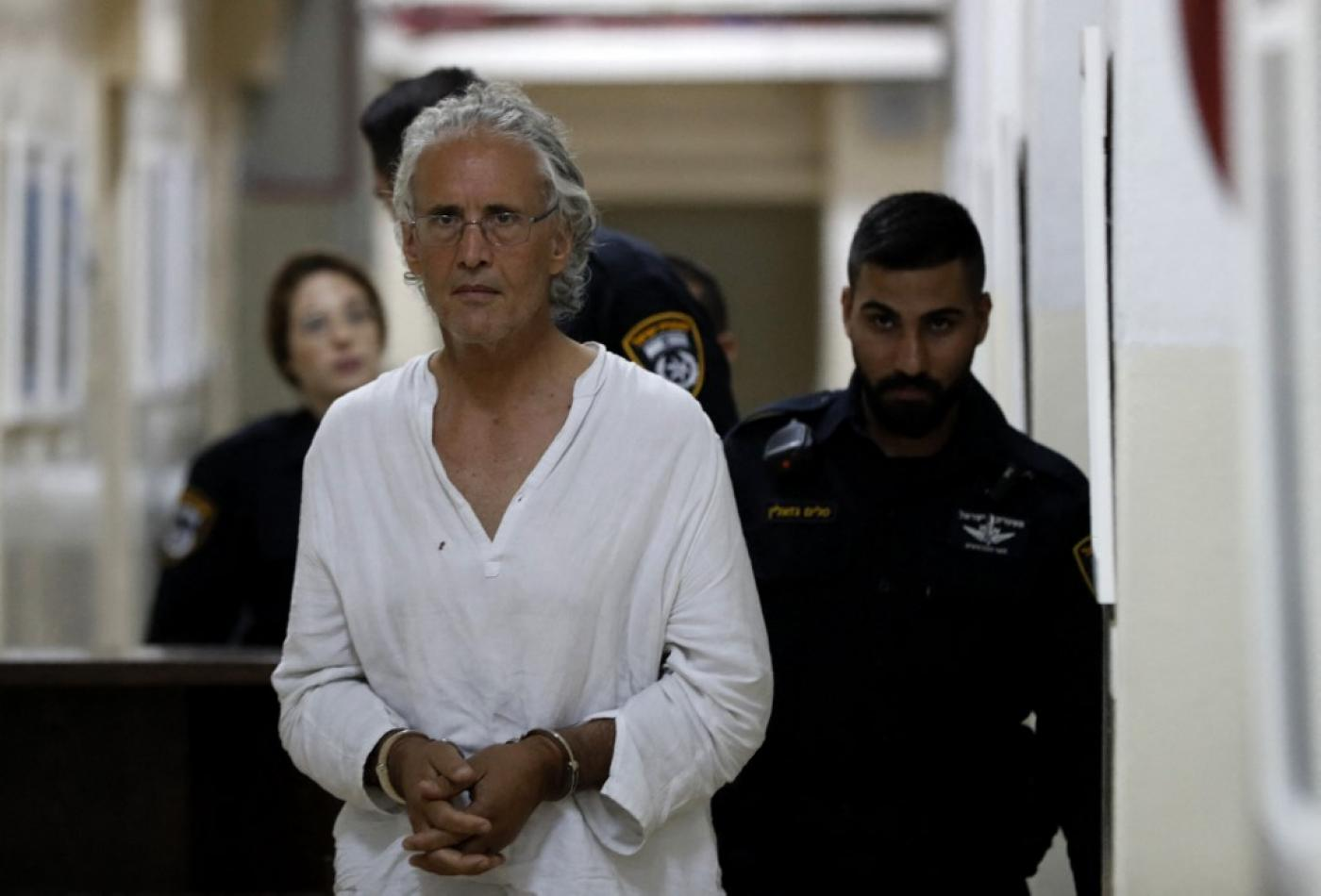 Frank Romano, who was arrested by Israel while protesting against the demolition of a Palestinian village in the West Bank, appears at the Jerusalem court on 16 September 2018 (AFP)