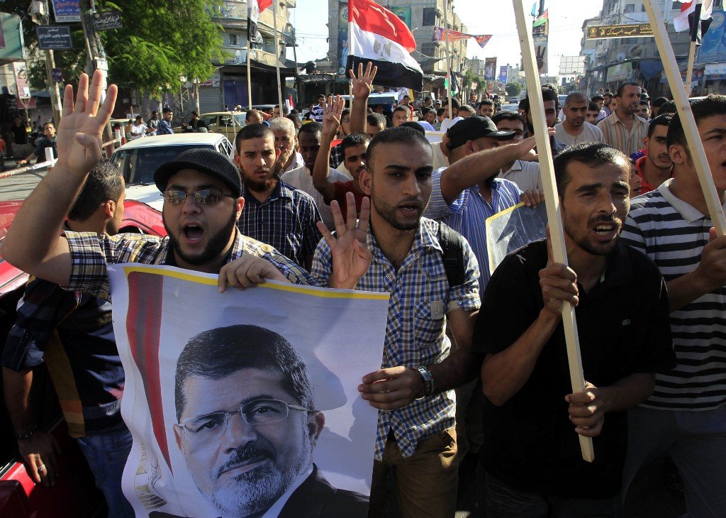 Palestinians in Gaza demonstrate in support of Morsi in 2013 (AFP)