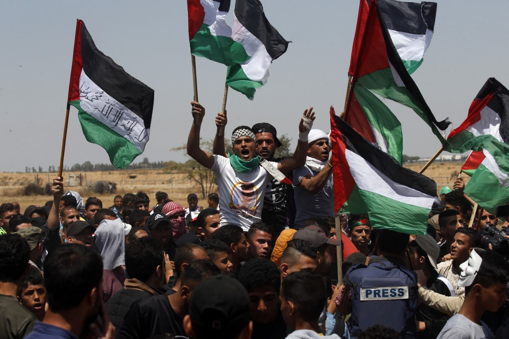 Palestinians in southern Gaza mark the Nakba anniversary in May 2019 (AFP)